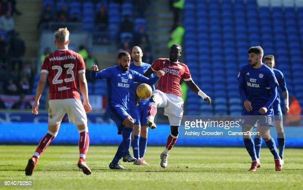 Cardiff City's Liam Feeney vies for possession with Bristol City's Famara Diedhiou during the Sky Bet Championship match between Cardiff City and...