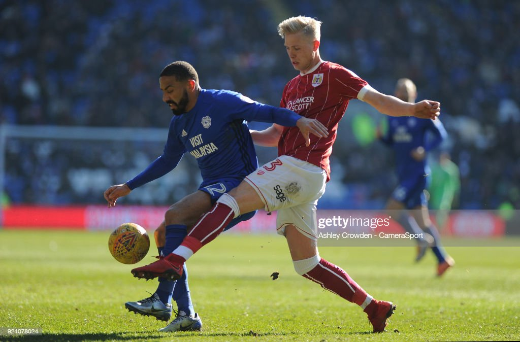 Cardiff City's Liam Feeney vies for possession with Bristol City's Hordur Magnusson during the Sky Bet Championship match between Cardiff City and Bristol City at Cardiff City Stadium on February 25, 2018 in Cardiff, Wales.