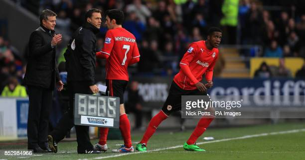 Cardiff City's Manager Ole Gunnar Solskjaer puts on Wilfried Zaha taking off Peter Whittingham during the Barclays Premier League match at Cardiff...