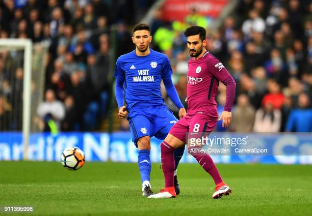 Cardiff City's Marko Grujic battles with Manchester City's Ilkay Gundogan during The Emirates FA Cup Fourth Round match between Cardiff City and...