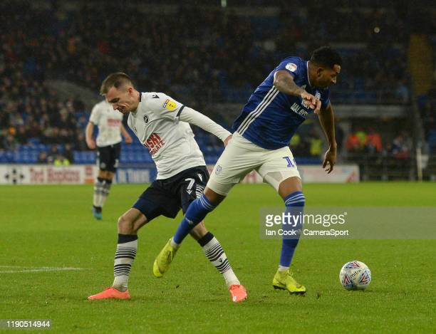 Cardiff City's Nathaniel MendezLaing battles with Millwall's Jed Wallace during the Sky Bet Championship match between Cardiff City and Millwall at...
