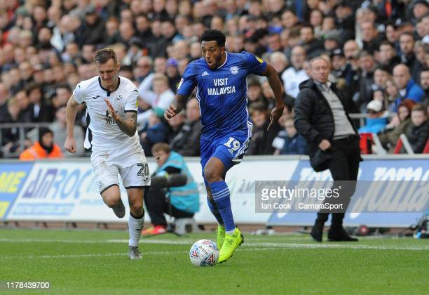 Cardiff City's Nathaniel MendezLaing breaks away from Swansea City's Ben Wilmot during the Sky Bet Championship match between Swansea City and...