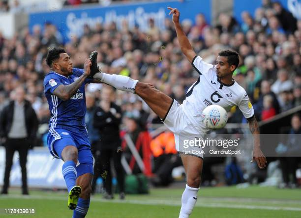 Cardiff City's Nathaniel MendezLaing nearly collides with Swansea City's Kyle Naughton high boot during the Sky Bet Championship match between...