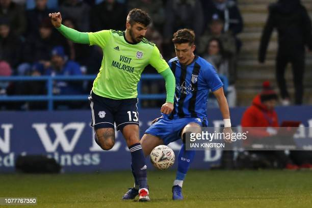 Cardiff City's Scottish defender Callum Paterson vies with Gillingham's English defender Alex Lacey during the English FA Cup third round football...
