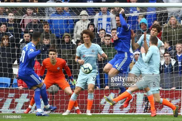 Cardiff City's Spanish midfielder Víctor Camarasa shoots to score the opening goal of the English Premier League football match between between...