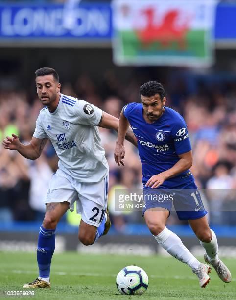Cardiff City's Spanish midfielder Víctor Camarasa vies with Chelsea's Spanish midfielder Pedro during the English Premier League football match...
