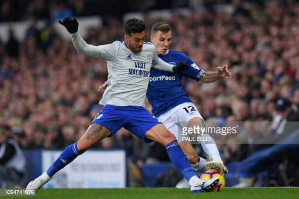 Cardiff City's Spanish midfielder Víctor Camarasa vies with Everton's French defender Lucas Digne during the English Premier League football match...