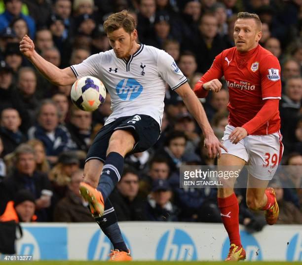 Cardiff City's Welsh striker Craig Bellamy vies with Tottenham Hotspur's Belgian defender Jan Vertonghen during the English Premier League football...