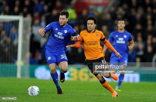 Cardiff City's Yanic Wildschut battles with Wolverhampton Wanderers' Helder Costa during the Sky Bet Championship match between Cardiff City and...
