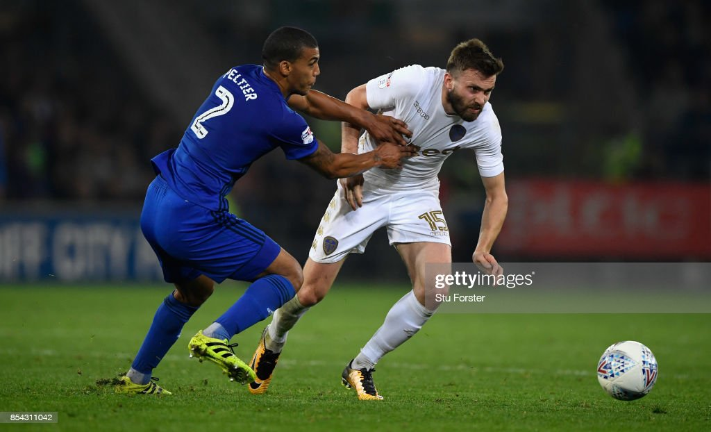 Cardiff defender Lee Peltier (l) challenges Stuart Dallas of Leeds during the Sky Bet Championship match between Cardiff City and Leeds United at Cardiff City Stadium on September 26, 2017 in Cardiff, Wales.