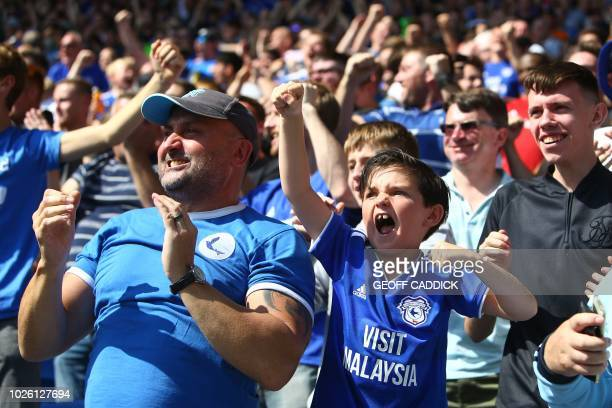 Cardiff fans celebrate their first goal during the English Premier League football match between between Cardiff City and Arsenal at Cardiff City...