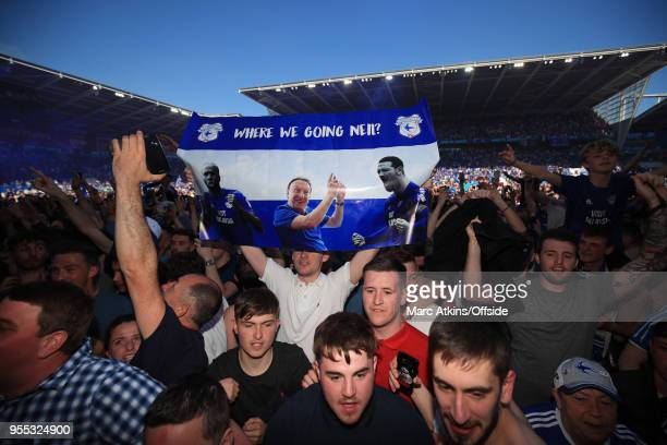 Cardiff fans celebrate with a banner featuring manager Neil Warnock during the Sky Bet Championship match between Cardiff City and Reading at Cardiff...