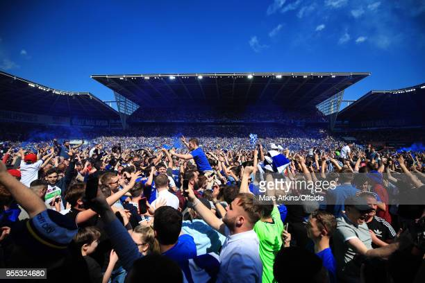 Cardiff fans invade the pitch as they celebrate promotion during the Sky Bet Championship match between Cardiff City and Reading at Cardiff City...