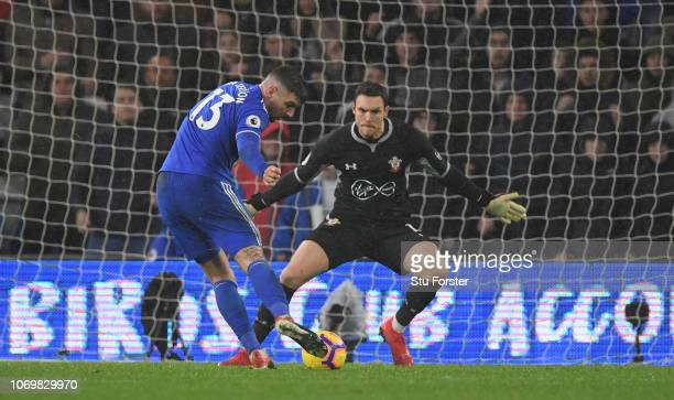 Cardiff forward Callum Paterson scores the winning goal past Southampton goalkeeper Alex McCarthy during the Premier League match between Cardiff...