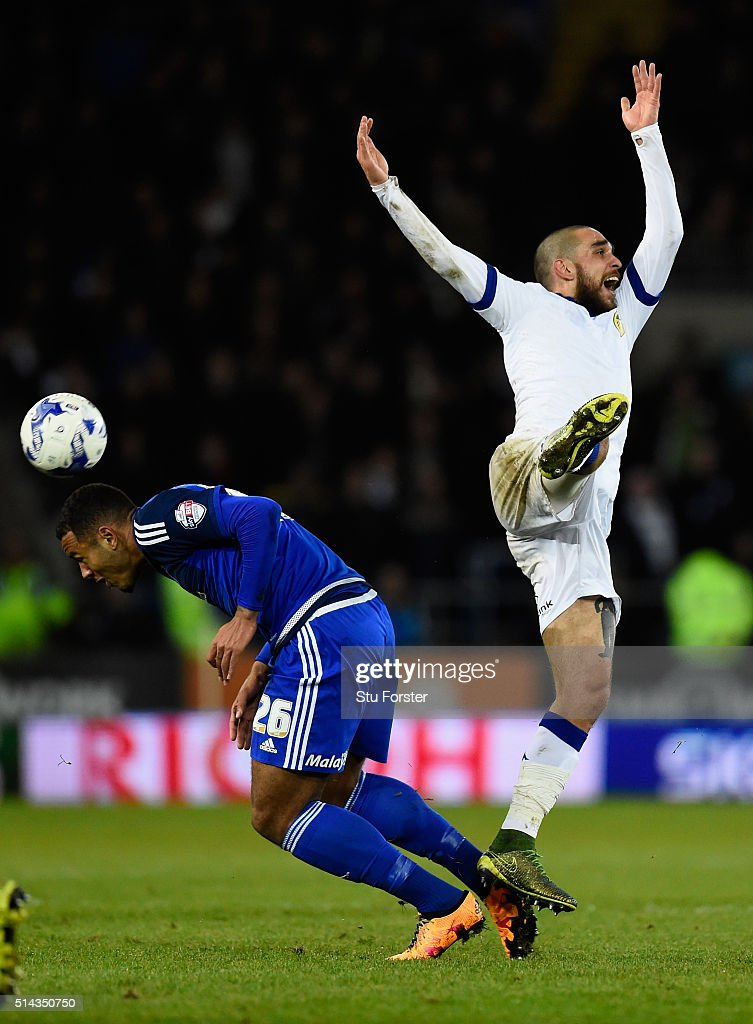 Cardiff forward Kenneth Zohore (l) challenges Guiseppe Bellusci of Leeds during the Sky Bet Championship match between Cardiff City and Leeds United at Cardiff City Stadium on March 8, 2016 in Cardiff, United Kingdom.