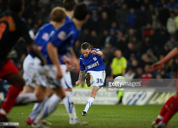 Cardiff forward striker Craig Bellamy scores a last minute second goal to draw the game during the npower Championship match between Cardiff City and...