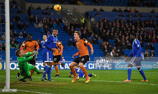 Cardiff goalkeeper Ben Amos makes a last ditch stop from Wolves player George Saville during the Sky Bet Championship match between Cardiff City and...