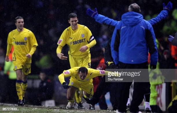 Cardiff goalscorer Michael Chopra is tripped up after scoring by Bristol City manager Gary Johnson during the FA Cup sponsored by EON 3rd Round match...