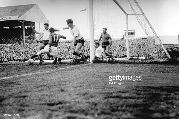 Cardiff leftwinger Leslie Lea tries to get the ball under control in the SV Hamburg goalmouth but the Germans manage to clear the ball during the...