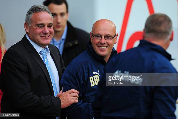 Cardiff manager Dave Jones shares a joke with Reading manager Brian Mcdermott before the npower Championship Play Off Semi Final Second Leg between...