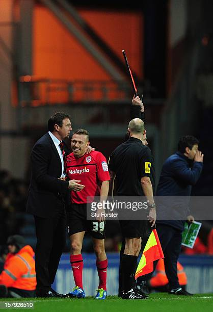 Cardiff manager Malky Mackay shares a joke with Craig Bellamy during the npower Championship match between Blackburn Rovers and Cardiff City at Ewood...