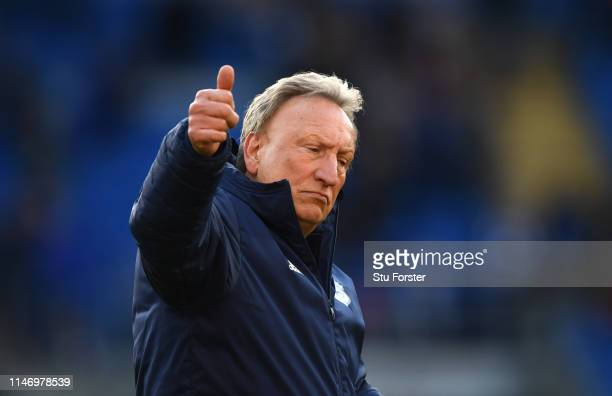 Cardiff manager Neil Warnock acknowledges the fans after the Premier League match between Cardiff City and Crystal Palace at Cardiff City Stadium on...