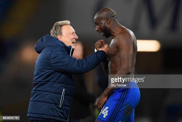 Cardiff manager Neil Warnock celebrates with defender Sol Bamba after the Sky Bet Championship match between Cardiff City and Norwich City at Cardiff...