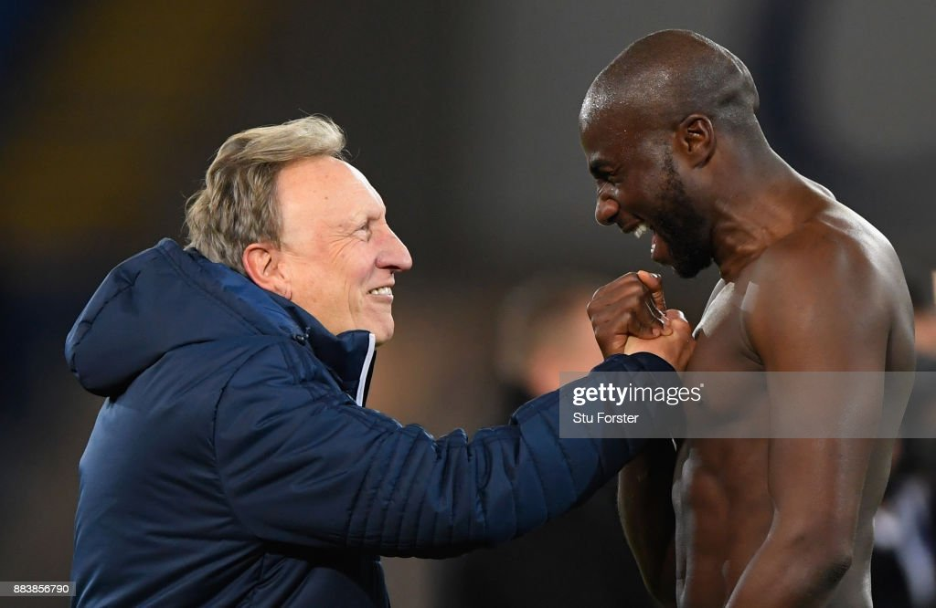 Cardiff manager Neil Warnock celebrates with defender Sol Bamba after the Sky Bet Championship match between Cardiff City and Norwich City at Cardiff City Stadium on December 1, 2017 in Cardiff, Wales.