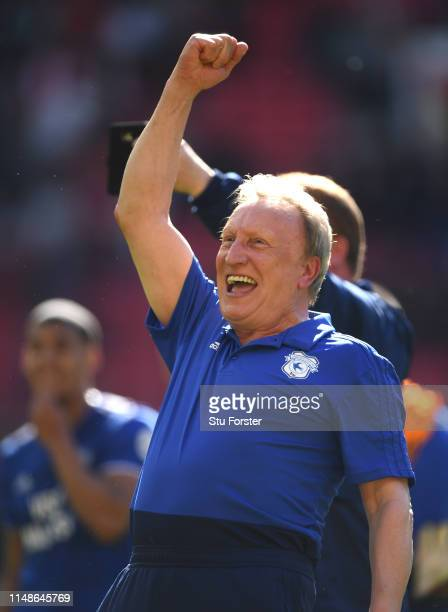 Cardiff manager Neil Warnock celebrates with the fans after the Premier League match between Manchester United and Cardiff City at Old Trafford on...