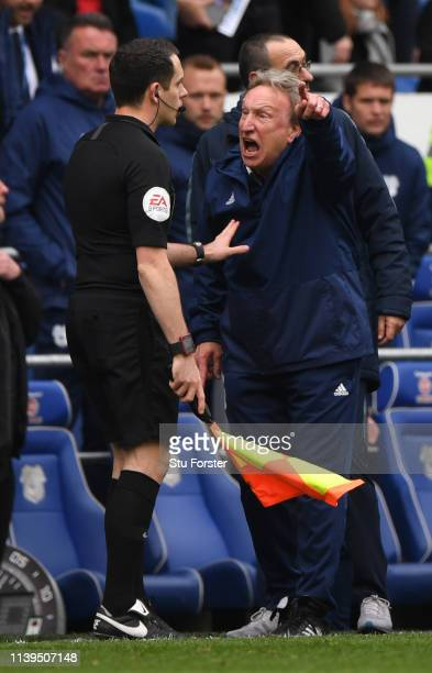 Cardiff manager Neil Warnock confronts the assistant referee during the Premier League match between Cardiff City and Chelsea FC at Cardiff City...