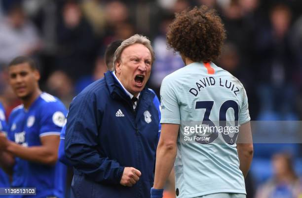 Cardiff manager Neil Warnock has words with Chelsea player David Luiz after the Premier League match between Cardiff City and Chelsea FC at Cardiff...