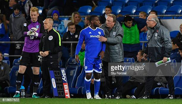 Cardiff manager Neil Warnock issues some advice to Junior Hoilett as Sheffield Wednesday sub goalkeeper Cameron Dawson prepares to enter the fray...