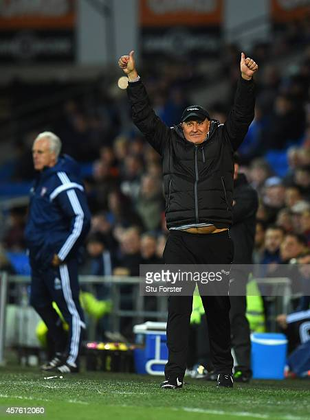 Cardiff manager Russell Slade celebrates as Ipswich manager Mick McCarthy looks on during the Sky Bet Championship match between Cardiff City and...