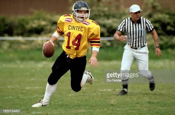 Cardiff Mets Canadian quarterback Gary Leyton in action as a referee looks on during a Coca Cola UK American Football League match on May 19th 1991...