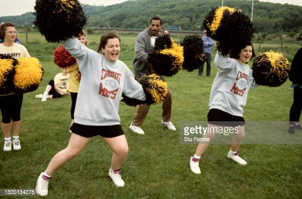 Cardiff Mets cheerleaders both male and female in action during a Coca Cola UK American Football League match on May 26th 1991 in Cardiff, United...