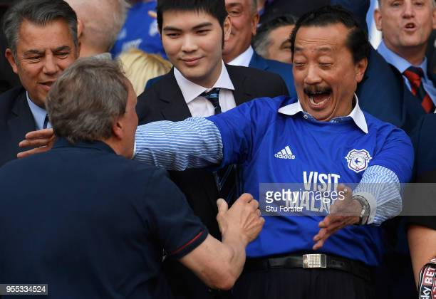 Cardiff owner Vincent Tan and manager Neil Warnock celebrate promotion to the premier league after the Sky Bet Championship match between Cardiff...