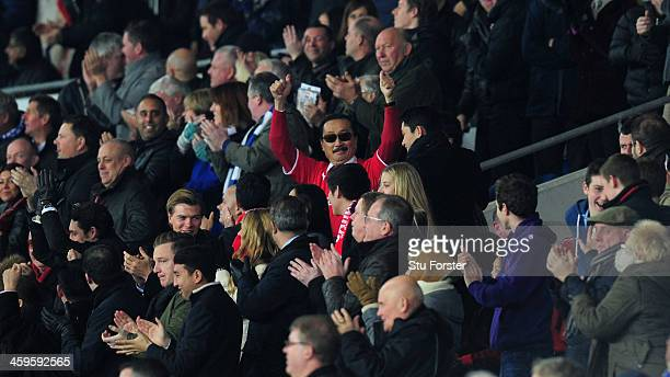 Cardiff owner Vincent Tan celebrates the opening goal during the Barclays Premier League match between Cardiff City and Sunderland at Cardiff City...