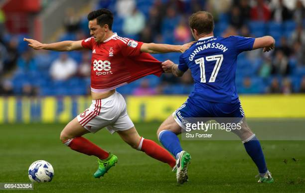 Cardiff player Aron Gunnarsson gets to grips with Zach Clough of Forest during the Sky Bet Championship match between Cardiff City and Nottingham...