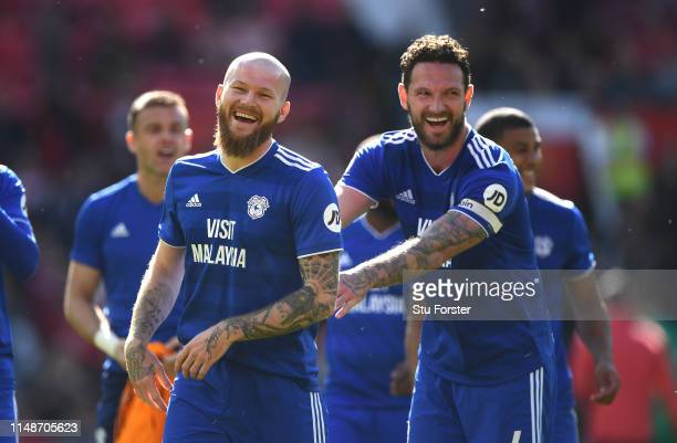 Cardiff player Aron Gunnarsson shares a joke with Sean Morrison after the Premier League match between Manchester United and Cardiff City at Old...