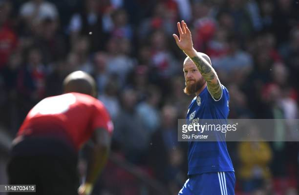 Cardiff player Aron Gunnarsson waves to the fans after being substituted in his final appearance during the Premier League match between Manchester...