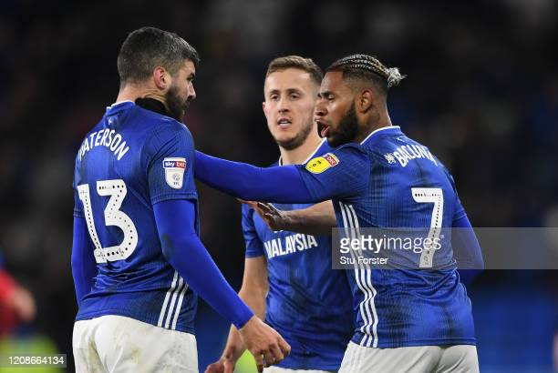 Cardiff player Callum Paterson is held by the throat by team mate Leandro Bacuna at the final whistle after the Sky Bet Championship match between...