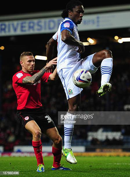 Cardiff player Craig Bellamy and Dickson Etuhu in action during the npower Championship match between Blackburn Rovers and Cardiff City at Ewood park...