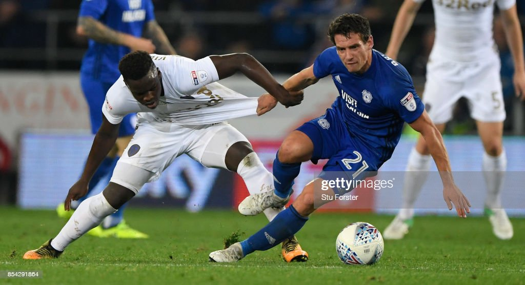 Cardiff player Craig Bryson (r) is challenged by Hadi Sacko of Leeds during the Sky Bet Championship match between Cardiff City and Leeds United at Cardiff City Stadium on September 26, 2017 in Cardiff, Wales.