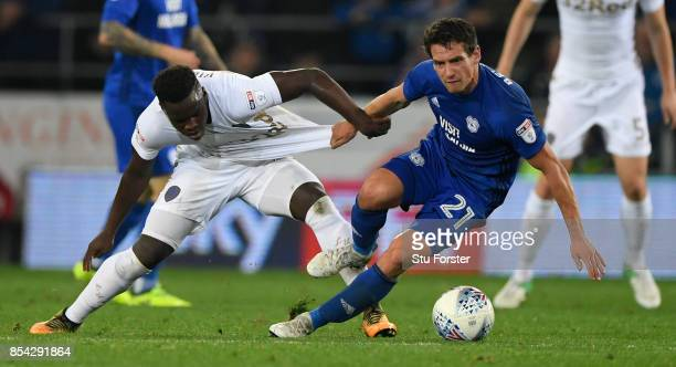 Cardiff player Craig Bryson is challenged by Hadi Sacko of Leeds during the Sky Bet Championship match between Cardiff City and Leeds United at...