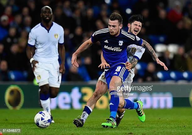 Cardiff player Joe Ralls challenges Leeds player Alex Mowatt during the Sky Bet Championship match between Cardiff City and Leeds United at Cardiff...