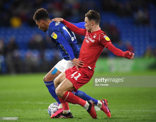 Cardiff player Josh Murphy is challenged in the box by Matty Cash of Forest but a penalty is not given during the Sky Bet Championship match between...