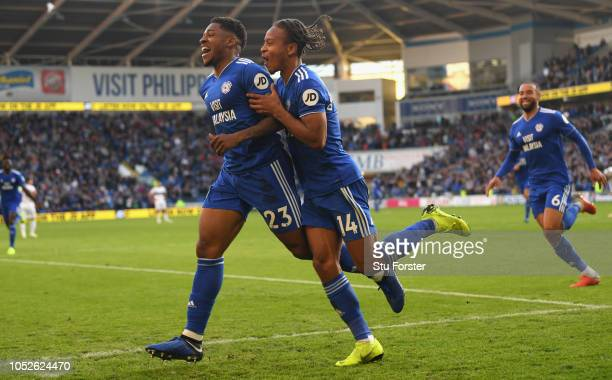 Cardiff player Kadeem Harris celebrates with Bobby DecordovaReid after scoring the fourth Cardiff goal during the Premier League match between...