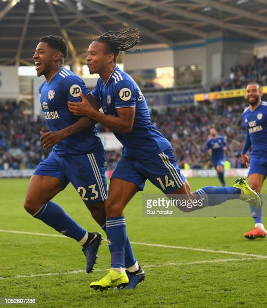 Cardiff player Kadeem Harris celebrates with Bobby DocordovaReid after scoring the fourth Cardiff goal during the Premier League match between...