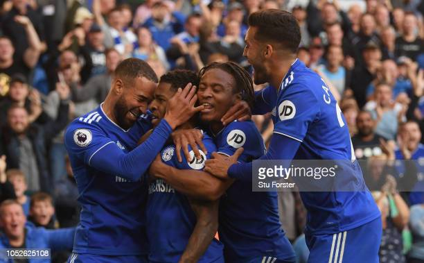 Cardiff player Kadeem Harris celebrates with team mates after scoring the fourth Cardiff goal during the Premier League match between Cardiff City...