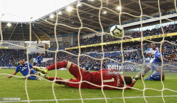 Cardiff player Kadeem Harris scores the fourth Cardiff goal past Fulham goalkeeper Marcus Bettinelli during the Premier League match between Cardiff...